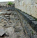 Capernaum synagogue wall with earlier basalt level. Photo copyrighted, BiblePlaces.