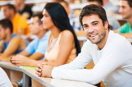 Students in college classroom. (Photo © iStockphoto)