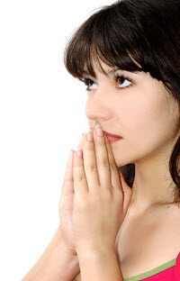 Woman praying. Photo copyrighted. © Alenaphoto | Dreamstime.com