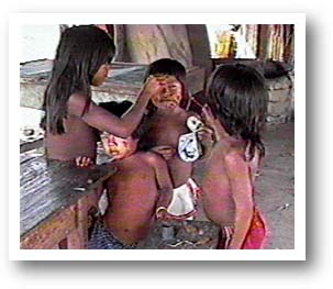 Indian children painting each other. Photo copyright by AAJ.
