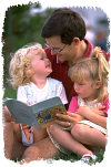 Father reading to daughters. Photo copyrighted. All rights reserved.