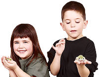 Children holding frogs. Photo copyrighted.