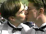 Two men kissing at a homosexual wedding. Copyrighted - Jeremiah Films.