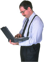Man working on investments using laptop computer. Photo copyrighted. Courtesy of Films for Christ.
