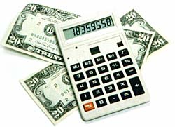 Money and calculator. Photo copyrighted. Courtesy of Films for Christ.