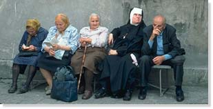 Nun on bench with others
