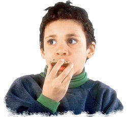 Boy eating cookie. Photo copyrighted