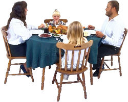 Family at dinner table. Photo copyrighted.