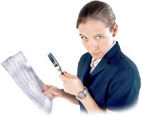 Woman with magnifying glass analyzing newspaper. Photo copyrighted.