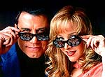 "John Travolta and Lisa Kudrow in ""Lucky Numbers"""