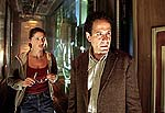 "Shannon Elizabeth and Tony Shalhoub in ""13 Ghosts"""