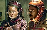 "Rosario Dawson and Eddie Murphy in ""The Adventures of Pluto Nash"""