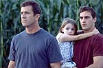 Mel Gibson, Abigail Breslin and Joaquin Phoenix. Scene from Signs. Copyright, Buena Vista Pictures