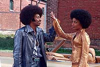 "Eddie Griffin and Aunjanue Ellis in ""Undercover Brother"""